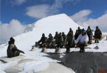 Soldiers doing yoga in the snow