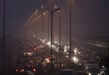 Cars in traffic in smog