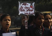 School children holding placards and shouting slogans during an awareness rally against the sexual violence against women & children