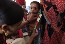 Mother and child measuring malnutrition