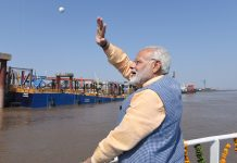 Narendra Modi waves from ferry