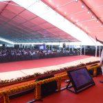 Narendra Modi at event waving to crowd