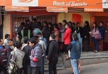 Queues outside an ATM after demonetisation was announced