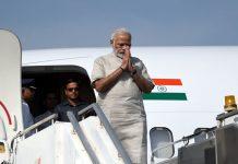 PM Narendra Modi de-boarding a plane in Jamnagar, Gujarat.