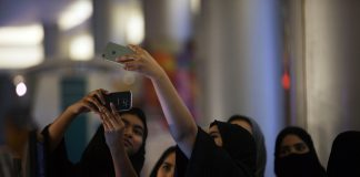 Saudi women take a selfie picture at a mall.