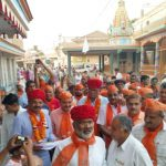 People in Madhapar village with a BJP candidate