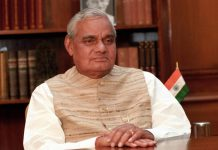 Atal Bihari Vajpayee sitting behind a desk