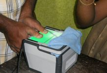 A person giving biometrics for Aadhaar