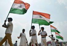 School children carrying Indian flags