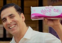 Akshay Kumar holding a packet of sanitary napkins in a promotion for Padman