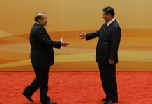 China's President Xi Jinping shakes hands with former Pakistani Prime Minister Nawaz Sharif
