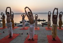 VARANASI, INDIA - APRIL 23: Young Indian Hindu Brahmins training to be priests perform yoga on a ghat on the Ganges River, holy to Hindus, at sunrise on April 23, 2014 in Varanasi, India. (Photo by Kevin Frayer/Getty Images)