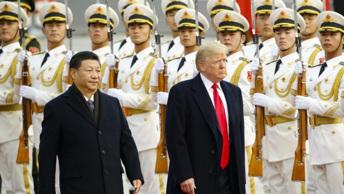 U.S. President Donald Trump with China's President Xi Jinping | Thomas Peter-Pool/Getty Images