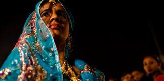 A woman during a wedding procession in New Delhi | Daniel Berehulak/Getty Images