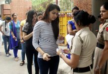 File image of UPSC candidates standing in queue for inspection by police personnel outside an exam centre in Gurugram   PTI