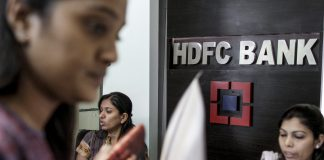 Women employees work in an HDFC Bank Ltd. branch in Mumbai, India | Bloomberg