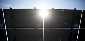 solar panels at a solar generating facility | Bloomberg