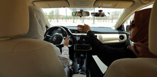 An instructor guides her trainee in driving skills during a training drive at the Saudi Aramco driving school for women