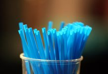 Blue straws in a glass | Godong/UIG via Getty Images