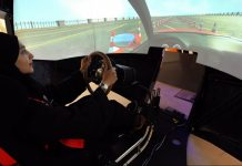 A woman learns using a driving simulator | Mohammed Al-Nemer/Bloomberg