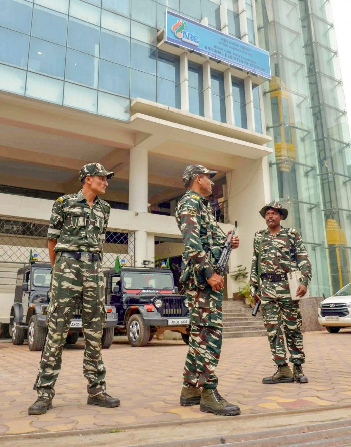 Security personnel guard in front of the NRC office at Bhangagarh in Guwahati | PTI