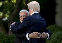 Narendra Modi hugs U.S. President Donald Trump in Washington, 2017 | Andrew Harrer/Bloomberg