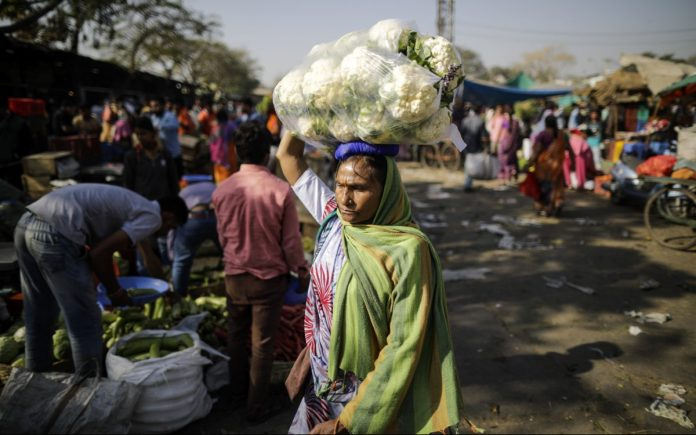 A woman at a vegetable market in Udaipur | Prashanth Vishwanathan/Bloomberg