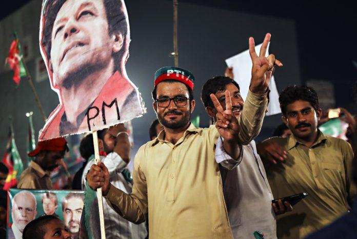 Supporters of Imran Khan, chairman of Pakistan Tehreek-e-Insaf | Asad Zaidi/Bloomberg