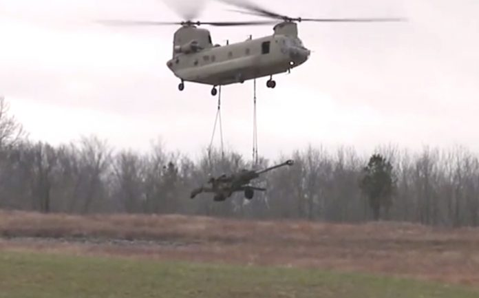 An M777 Ultra Light Howitzer underslung from a Chinook helicopter   YouTube