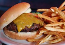 A cheeseburger and french fries