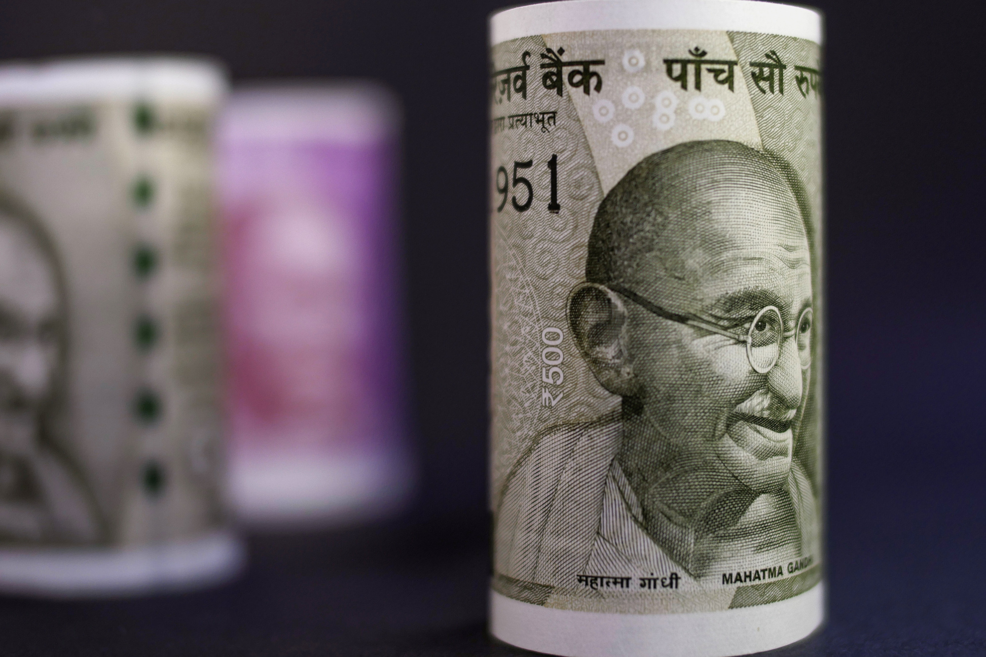 india's rupee slides to a record India's rupee hit a new low against the us dollar on thursday, falling to 7082 at  one stage in morning trading this came on the back of a.