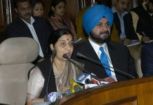 Navjot Singh Sidhu with Sushma Swaraj at Parliament House in New Delhi | Getty Images