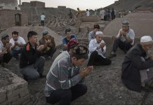 Uyghur men perform prayers in Xinjiang province, China | Kevin Frayer/Getty Images