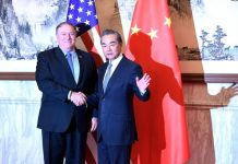 Mike Pompeo and Wang Yi in Beijing | Bloomberg