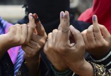 Muslim women show their ink stained finger after casting their vote | Sheeraz Rizvi/Hindustan Times via Getty Images
