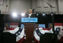 Former US President Barack Obama addresses the crowd in support of Georgia Democratic Gubernatorial candidate Stacey Abrams during a campaign rally on 2 November in Atlanta, Georgia