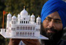 Artist Gurpreet Singh shows his paper model of Kartarpur Sahib gurdwara | PTI