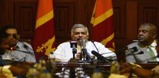 Sri Lankan Prime minister Ranil Wickremesinghe (C) takes part in a press conference in Colombo   Getty Images