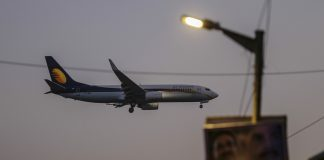 A Jet Airways India Ltd. plane prepares to land at Chhatrapati Shivaji International Airport in Mumbai | Dhiraj Singh/Bloomberg