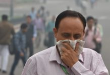 A pedestrian covers his face with a handkerchief for protection against air pollution in New Delhi | Shahbaz Khan/PTI