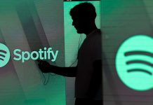 An illuminated screen bearing the Spotify Technology SA logo in London | Chris Ratcliffe/Bloomberg