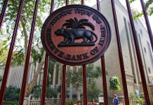 RBI logo displayed on a gate at the central bank's headquarters in New Delhi | Bloomberg/Bloomberg
