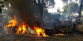 Vehicles set on fire by a mob during a protest over the alleged illegal slaughter of cattle | PTI
