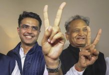 Congress leaders Ashok Gehlot (R) and Sachin Pilot (C) flash victory signs after the declaration of Rajasthan Assembly election result | PTI