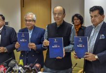 Arun Jaitley with NITI Aayog Vice Chairman Rajiv Kumar and CEO Amitabh Kant (R) release NITI Aayog's Strategy Document for New India@75
