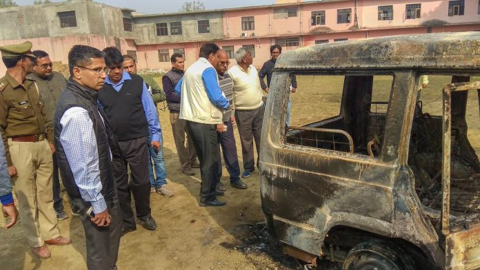 Policemen inspect vehicles set on fire by a mob during a protest in Bulandshahr   PTI