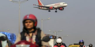 An Air India aircraft lands at Chhatrapati Shivaji International Airport in Mumbai | Dhiraj Singh/Bloomberg