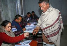 An election officer put an indelible ink mark on the finger of a voter | PTI