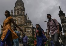 Commuters and pedestrians walk past the Chhatrapati Shivaji Terminus railway station in Mumbai (Representational image)
