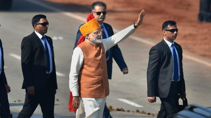 Prime Minister Narendra Modi waves at the crowd after attending the 70th Republic Day celebrations at Rajpath, in New Delhi  Kamal Kishore/PTI